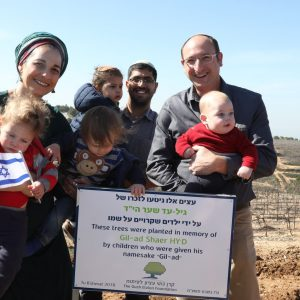 Planting with children named after Gil-Ad Photo: Miriam Tzachi